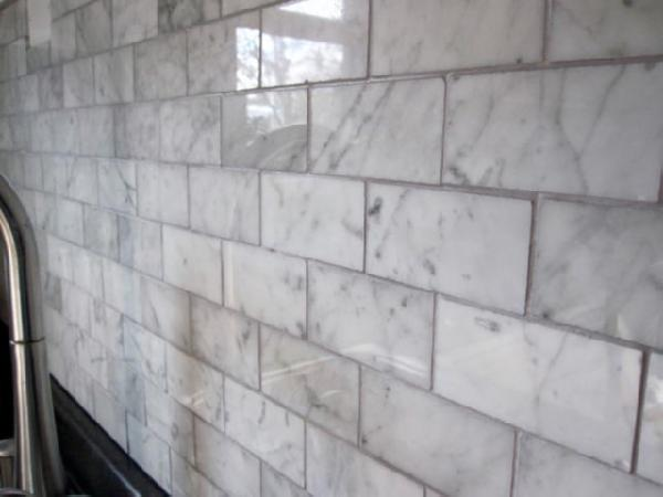 close up of our carrara marble backsplash diy