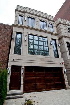 Garage under house transitional home exterior for Nyc townhouse with garage