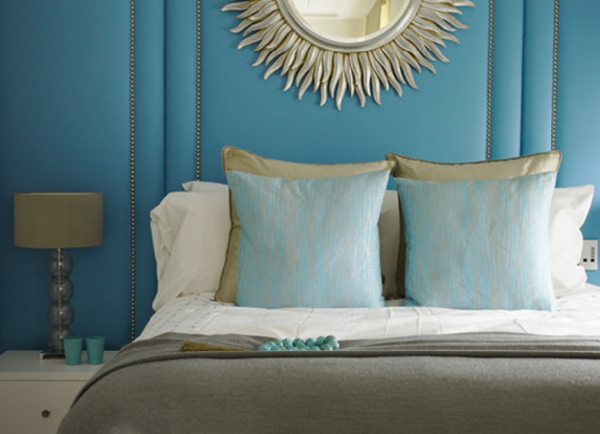 star burst mirror blue grey bedroom with turquoise blue walls silver sunburst mirror gray flannel blanket gold and blue silk pillows and lamp