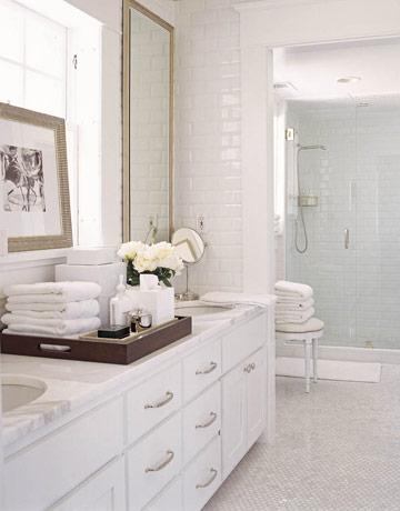 Clean Crisp White Bathroom Design With White Carrara Marble Hexagon Floors Tiles And White Carrara Marble Counter Tops White Bathroom Cabinets