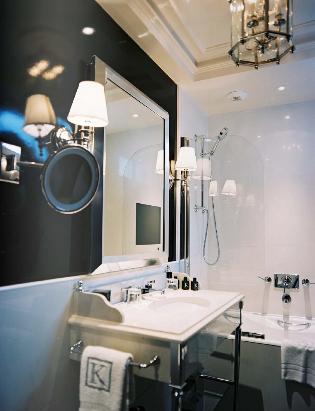 Modern Black Bathroom Design With Beveled Mirror Chrome Sconces Marble Vanity Base Walls Paint Color Lantern Pendant Lighting