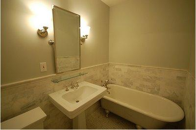 Small Bathroom With Sconces And Claw Foot Tub