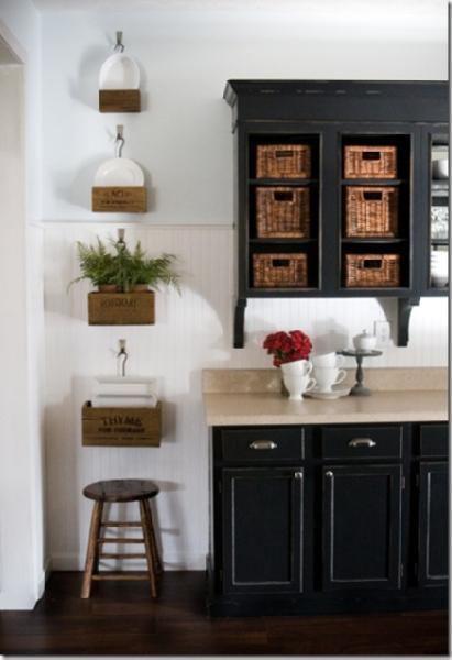 Painted Black Kitchen Cabinets, Wicker Baskets, Wall Boxes, Wood Stool,  White Wainscoting And Soft Porcelain Blue Paint Color.