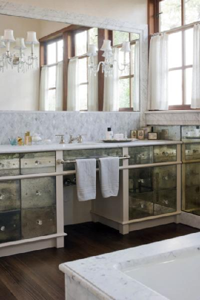 lovely elegant bathroom antique mirror bathroom vanity vanities marble countertops crystal sconces mocha wood floors white carrara marble tub and