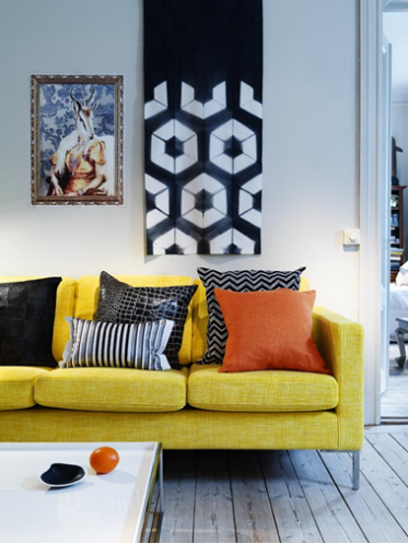 Camilla Julner Yellow Sofa, Orange And Black Black Zigzag Chevron Pillow,  Striped Black Pillow, Plank Floors, Floor Lamp, Art And White Modern Coffee  Table. Part 82