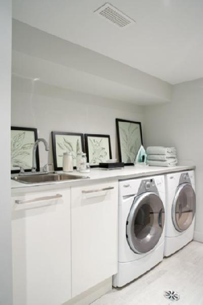Peter Fallico - Clean, modern laundry room! White Ikea cabinets, framed  botanical, prints, chrome fixtures and soft gray green walls.