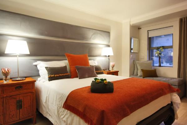 Gray and orange bedding contemporary bedroom - Spots of color in the bedroom linens and throws ...