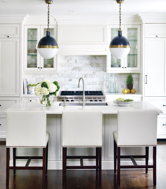 sleek white leather barstools with marble peninsula - transitional