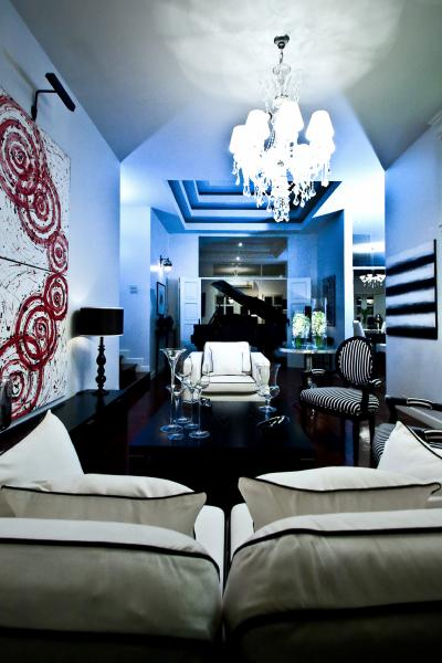 Nice Monochromatic Living Room With Blue Light Effect. White And Red Abstract  Art, White Sofa With Black Piping And Glossy Black Table. Part 21