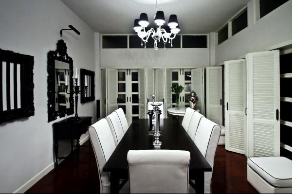 Monochromatic Dining Room   Black Dining Table, White Dining Chairs, Black  Crystal Chandelier And Black Mirror.