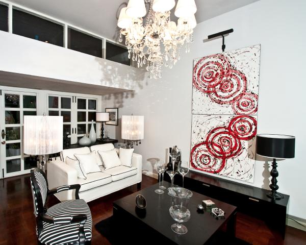 White Living Room With Bright Red Artwork Accent. White And Red Abstract  Art, Glossy Black Lacquer Table And White Sofa With Black Piping.