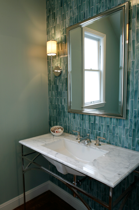turquoise blue powder room design with blue glass tiles backsplash