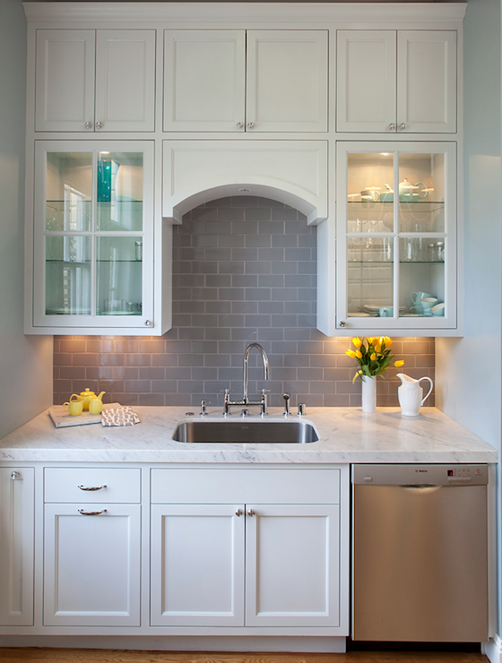 kitchen cabinets, gray subway tile backsplash, glass front cabinets
