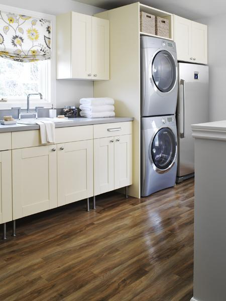 cream and gray laundry room design with ivory cabinets gray counter