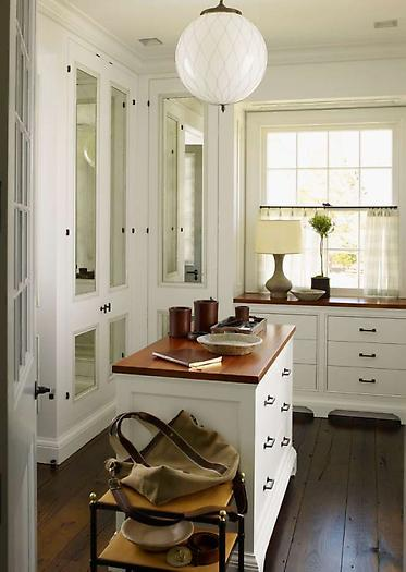 Walk In Closet With Mirrored Doors White Cabinets Butcher Block Countertops Island Globe Pendant And Rustic Wood Floors