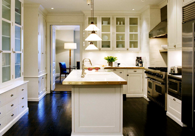 Gorgeous white kitchen design with white kitchen cabinets, espresso stained wood  floors, tapered glass pendant island lights, glass front cabinets, ... - Dark Wood Floors Design Ideas