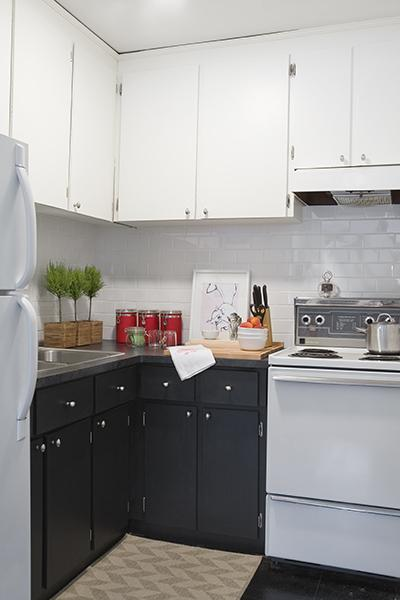 Virginia Macdonald Photography - HGTV's Pure Design - White & black kitchen design with white kitchen cabinets, black kitchen cabinets, and subway tiles.