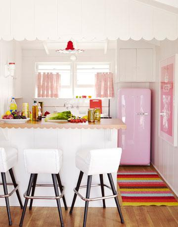 Pink refrigerator, white counter stools, ruffled pink drapes, white kitchen  cabinets, peninsula, striped green red fuchsia turquoise blue brown rug, ...