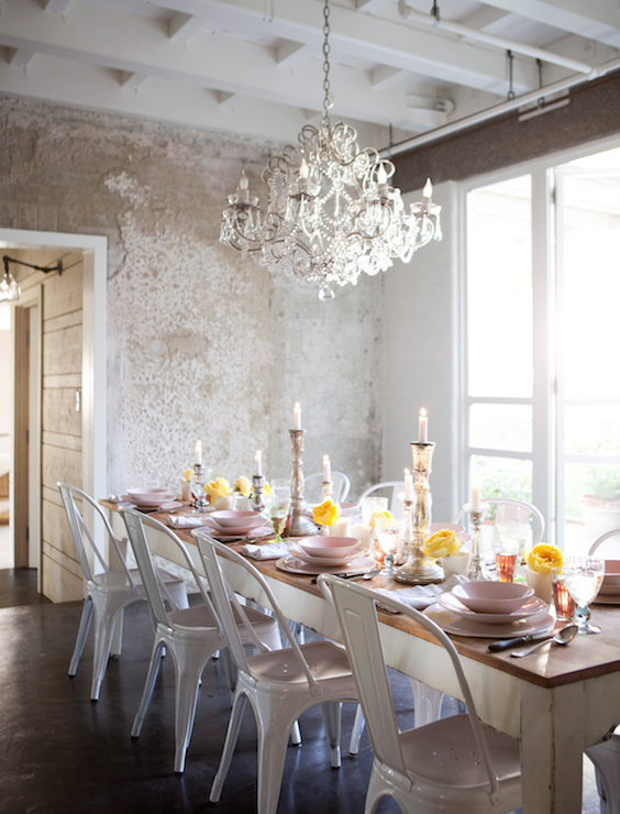 Eclectic Dining Room Design With White Tolix Chairs Rustic Farmhouse Table Crystal Chandelier And Metallic Wallpaper