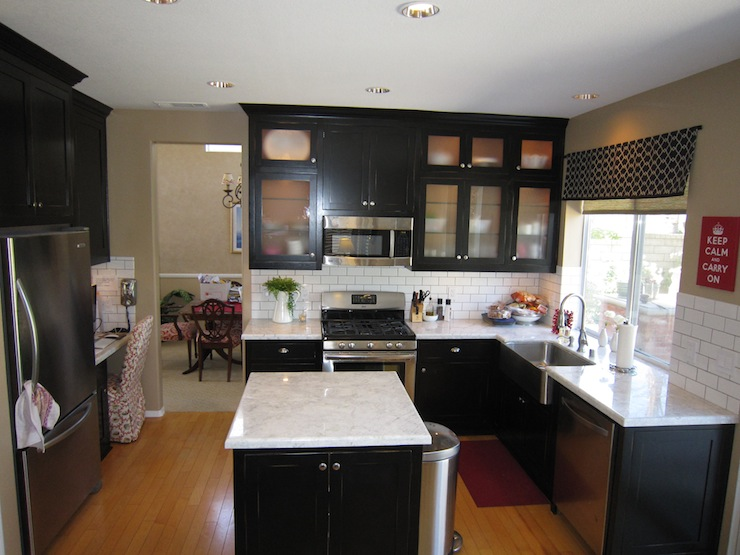 Kitchen black shaker cabinets quartzite counters white subway tile