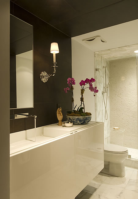 Brown And White Bathroom. Glossy white lacquer modern floating bathroom vanity  chocolate brown walls faucet sconces marble tiled floors and frameless glass shower White Bathroom Vanity Design Ideas