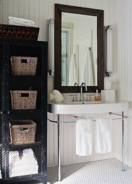 beachy cottage bathroom design with beadboard chrome bathroom sink beveled mirror penny tiles modern sconces and black bathroom storage cabinet