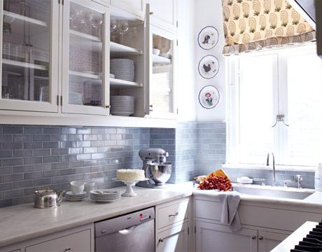 Small, cozy white & blue kitchen design with white glass-front kitchen  cabinets, calcutta marble countertops, blue subway tile backsplash and  decorative ... - Blue Glass Subway Tile Backsplash Design Ideas