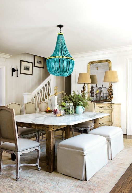 Meg Adams Contemporary French Dining Room Design With Turquoise Empire Chandelier Marble Tabletop Chairs And Ottomans