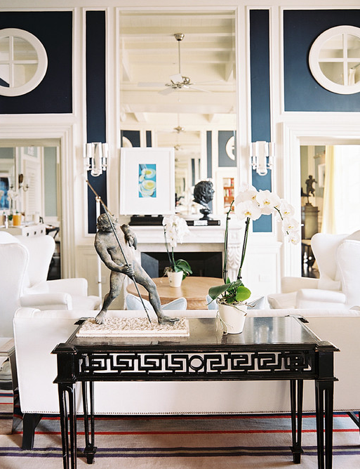 Gorgeous Blue Living Room Design With Fireplace Mirror Black Iron Console Table White Wingback Chairs Striped Rug Sconces And Walls Paint Color