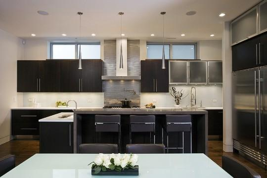 Modern Kitchen With Espresso Ebony Stained Cabinets, Modern Leather Stools  And Stainless Steel Appliances. Design Ideas