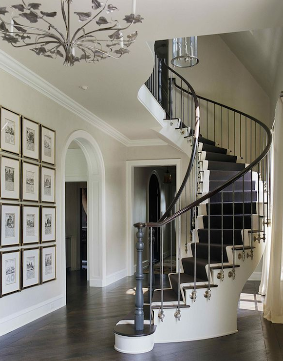 Spiral staircase transitional entrance foyer for Foyer staircase ideas