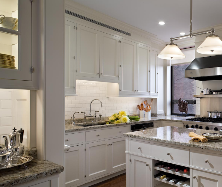with white kitchen glass front cabinets, gray granite countertops