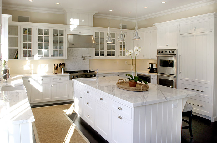Sunny White Kitchen Design With White Glass Front Kitchen Cabinets,  Calcutta Marble Countertops Backsplash, Pot Filler, Kitchen Island, Sisal  Rug And ...
