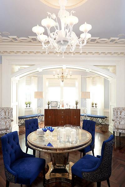 White Royal Blue Elegant Living Room Design With Velvet Tufted Dining Chairs Round Mirrored Pedestal Table Wood Floors In A
