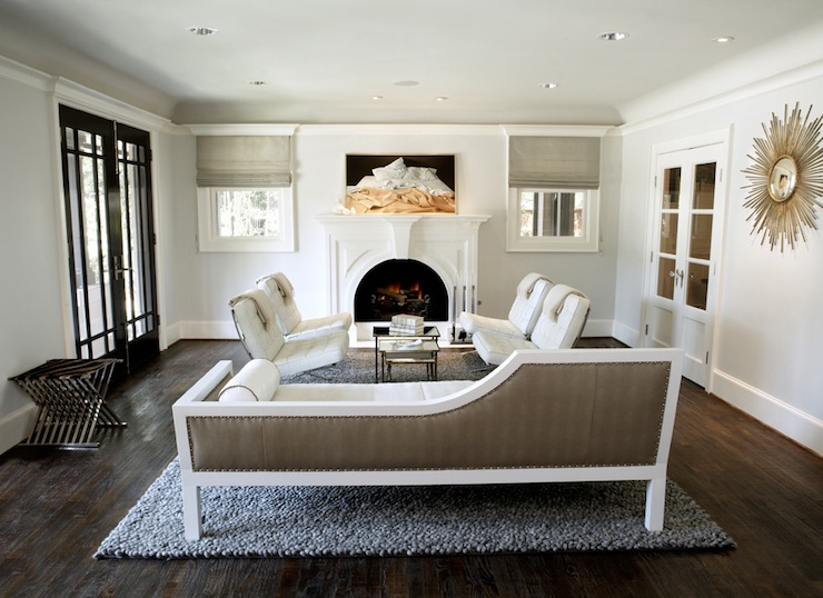 Taupe living room design with white leather tufted barcelona chairs