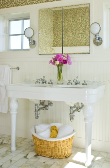Cottage beachy bathroom design with white Parisian pedestal double sinks  calcutta gold marble tiles floor  mirror  sconces  beadboard  yellow  amp  green. Pedestal Sink Design Ideas