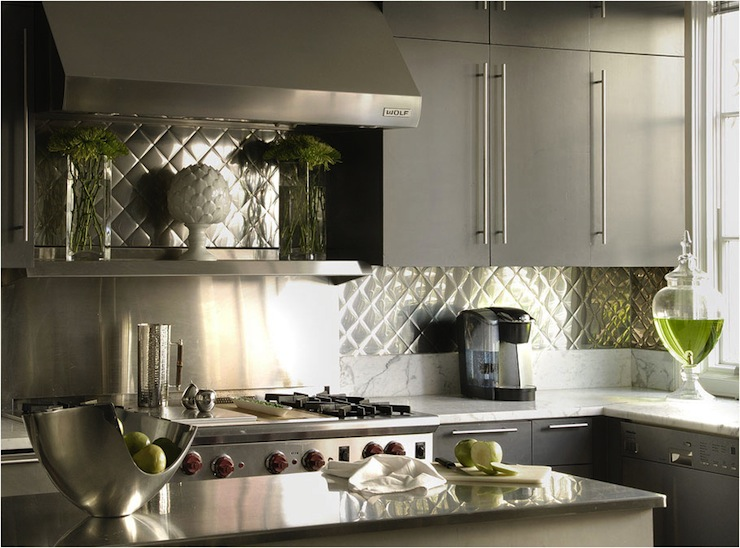 with gray kitchen cabinets, modern hardware pulls, aluminum backsplash