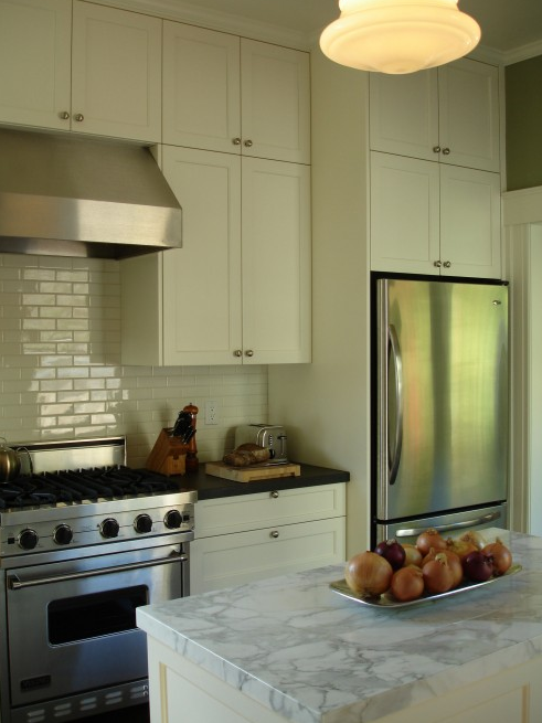with cream shaker kitchen cabinets, glossy off white subway tiles
