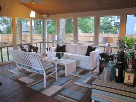 Screened Porch With Blue And Gray Carpet Tile Rug
