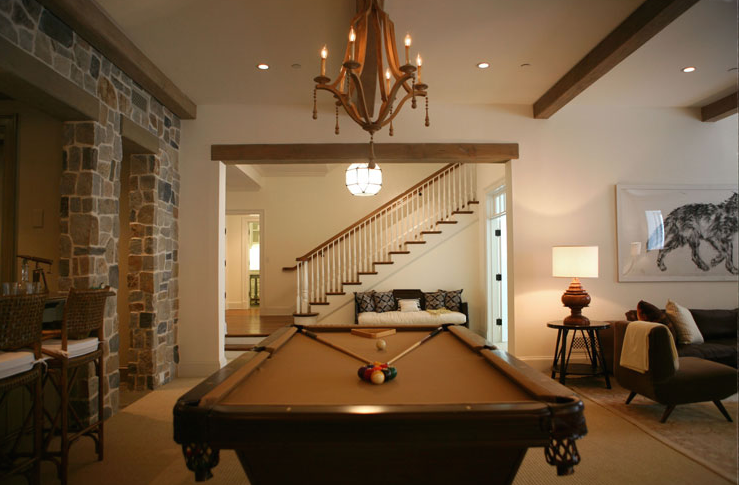 Nice Chic, Sophisticated Basement Design With Pool Table, Currey And Company  Simplicity Chandelier And Exposed Wood Beams.