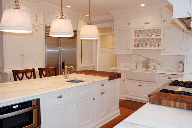 calcutta gold marble counter tops & backsplash, white kitchen island