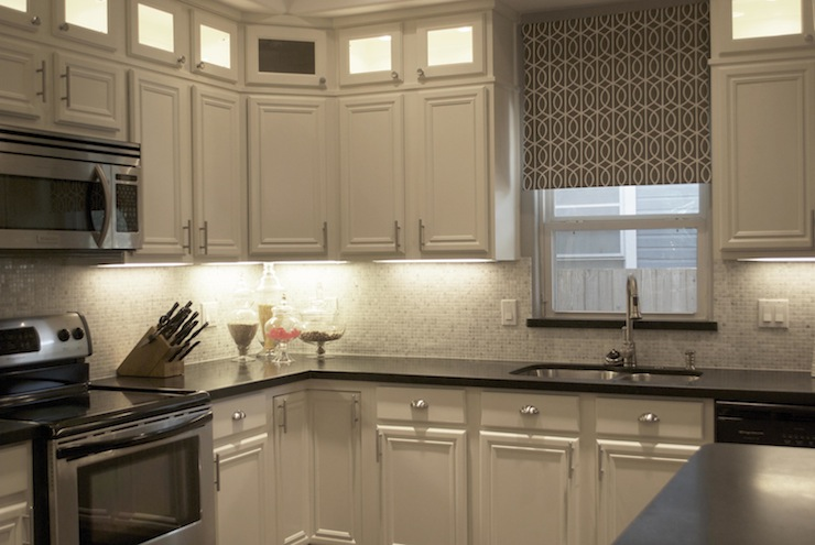 Gray roman shade transitional kitchen a well dressed for Gray kitchen cabinets with black counter