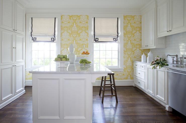 kitchen design with yellow wallpaper, white kitchen cabinets, white
