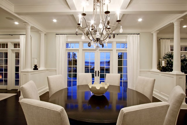 Chic Elegant Dining Room Design With Glossy Wood Round Pedestal Table Gray Parsons Chairs Chandelier French Doors Transom Windows And White