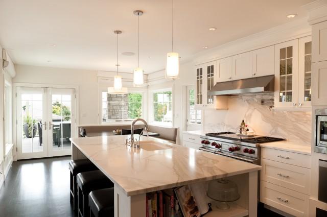 calcutta gold marble backsplash & counter tops, white kitchen island