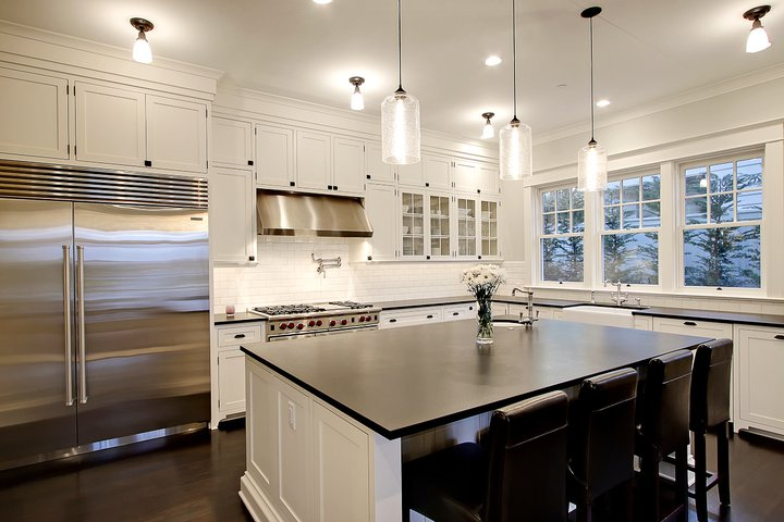 Chic White Black Kitchen Design With White Glass Front Kitchen
