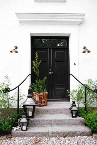 Black double doors cottage home exterior for Home double entry doors