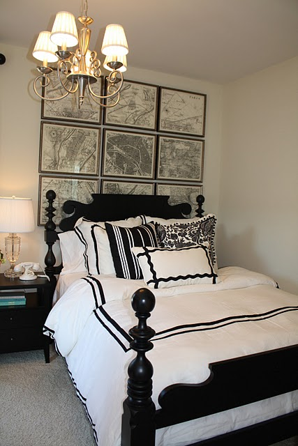 charlotte home tour chic vintage map art brass chandelier black wood bed white hotel bedding with black frame and crystal urn lamps