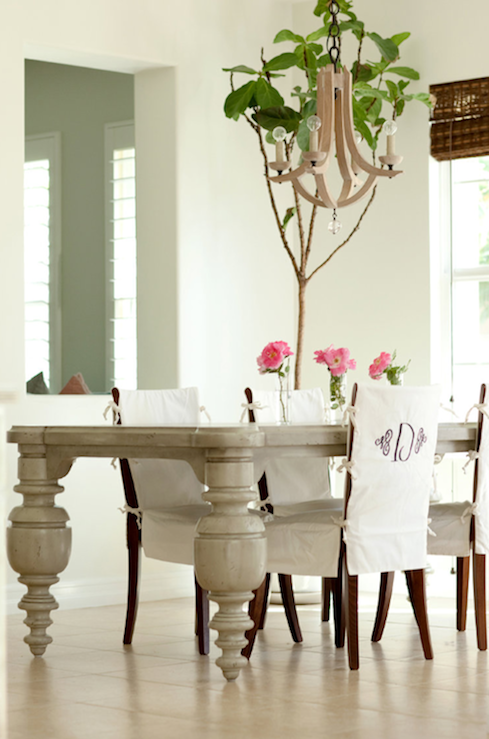 Adorable Modern French Dining Room Design With Gray Table Monogrammed Slip Covered Chairs Wood Chandelier And Bamboo Roman Shades