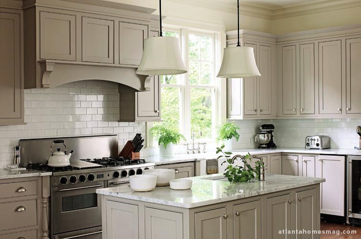 design with gray shaker kitchen cabinets, white carrara marble counter